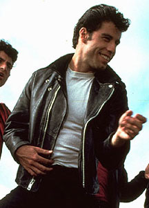 John Travolta as Danny Zuko in Grease wearing a leather jacket